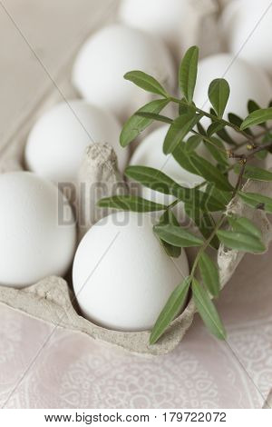 Easter holyday eggs on pale background in natural light