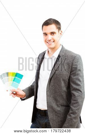 Studio shot of male interior designer with color swatches