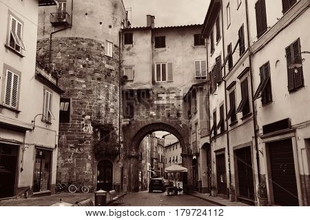 Lucca street view with archway in Italy
