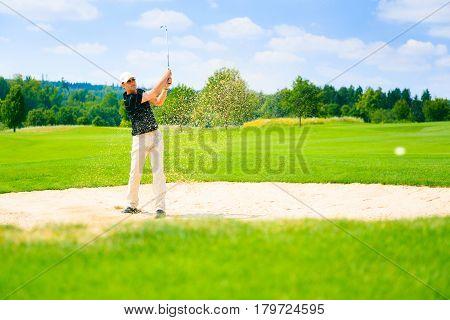 man playing golf, enjoying a summer activity.