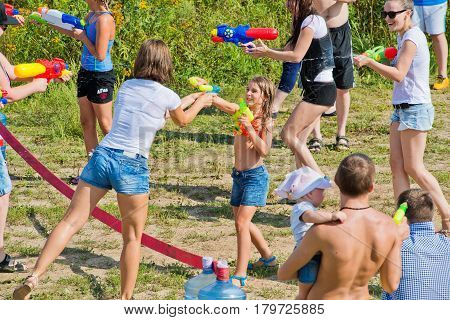 Russia. Moscow. August 6, 2016. People splash out of water pistols in the open air