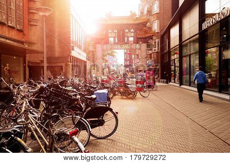 Netherlands , The Hague, June 2016, Chinatown Gate at sunset in the center of The Hague, Netherlands. Road with bike parking in the district populated by Chinese in the Dutch capital