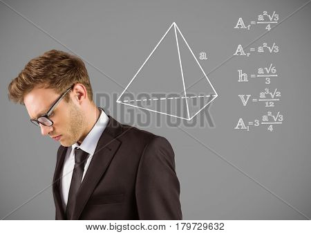 Digital composite of Businessman with equations drawing graphics