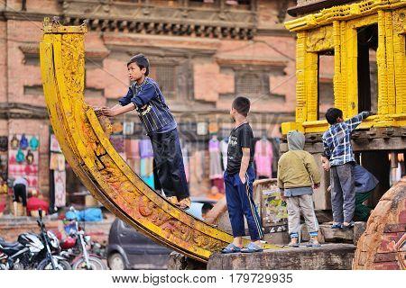 April 03 2015 Bhaktapur Nepal. Children playing on Bhairava Chariot before Bisket Jatra festival.