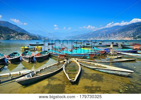 Colorful boats on Phewa lake Pokhara Nepal. Wide angle landscape