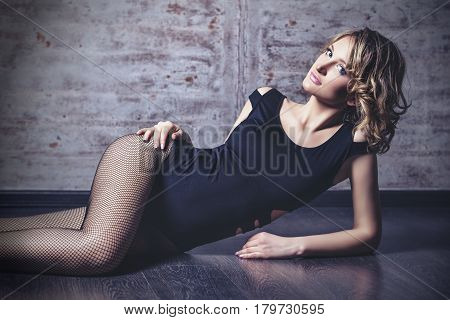 Beautiful Woman Model Blonde Sensual And Fashionable At The Background Of Metal Wall