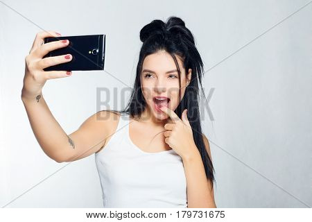 Selfie Time. Young Smiling Blond-haired Lady Doing Selfie On Gray Background