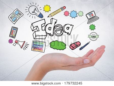 Digital composite of Hand with idea doodles against white wall
