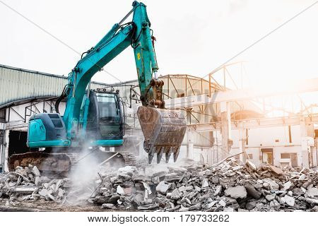 Excavators machine in construction site demolishing existing building