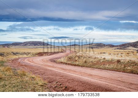 Dirt ranch road at foothills in northern Colorado, early spring scenery