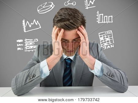 Digital composite of Businessman stressed with figures and charts drawings graphics