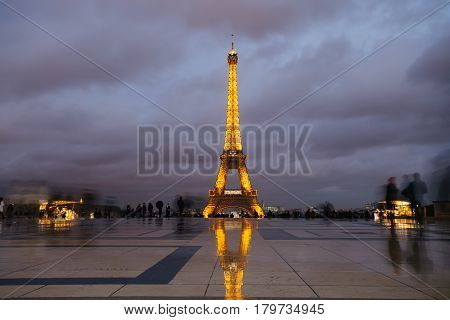 Paris, France - October 2016. Eiffel Tower In Night. Famous Historical Landmark On The Quay Of A Riv