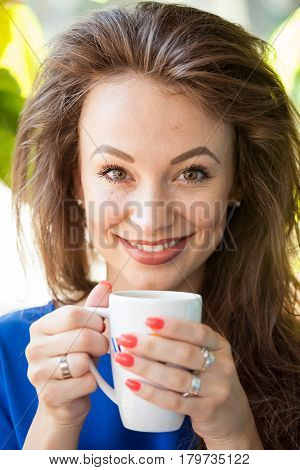 Gorgoues young woman drinking a cup of coffee. Coffee drinker.