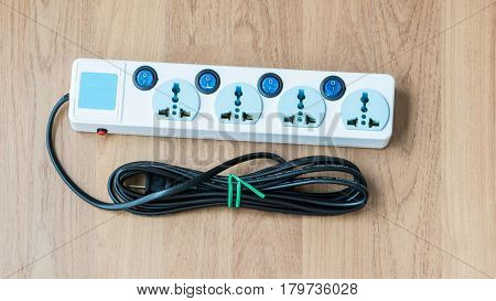 Useful Extension Cords set on wood background