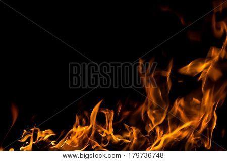 Photo of hot sparking live-coals burning, spark of bonfire.