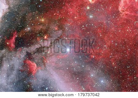 Nebulae and many stars in outer space. Elements of this image furnished by NASA.