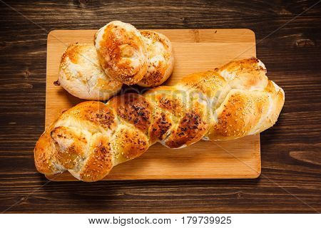 Pastry - crispy buns on wooden table
