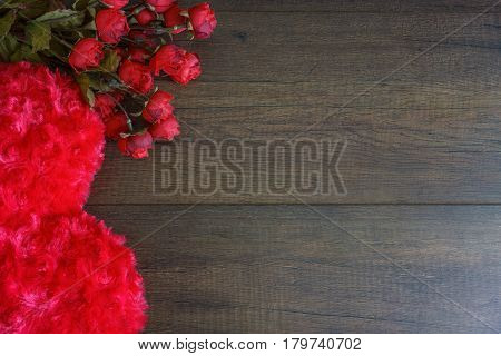 Heart shaped pillow and roses on wood background Valentine's day concept
