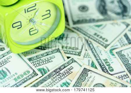 Time is money concept : Clock placed on U.S dollar bills