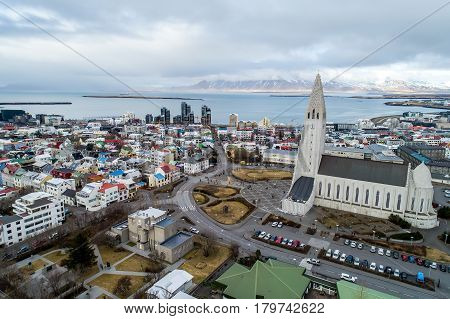 Aerial View Of Famous Hallgrimskirkja Cathedral And The City Of Reykjavik In Iceland