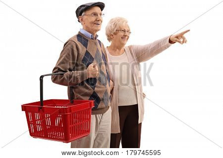 Elderly man holding a shopping basket with an elderly woman pointing isolated on white background