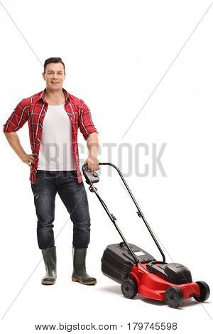 Full length portrait of a male gardener with a lawnmower isolated on white background