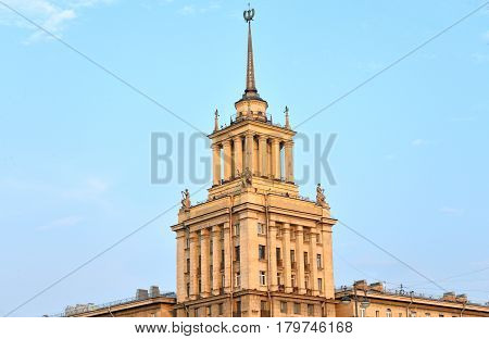 High-rise building in the neoclassical style on Moskovsky Avenue in Saint Petersburg at sunny summer evening.