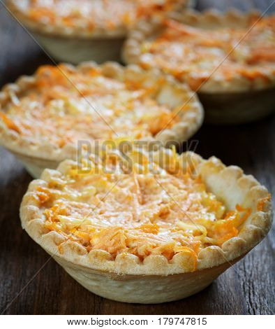 Still Life Of Tartlets With Cheese And Carrots
