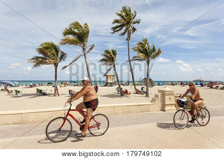 Hollywood Beach Fl USA - March 13 2017: Bicycle rider at the Hollywood Beach Broad Walk on a sunny day in March. Florida United States