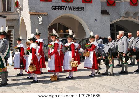 Neuoetting,Germany-May 26,2016: People in typical bavarian dress stand in a procession on Corpus Christi day