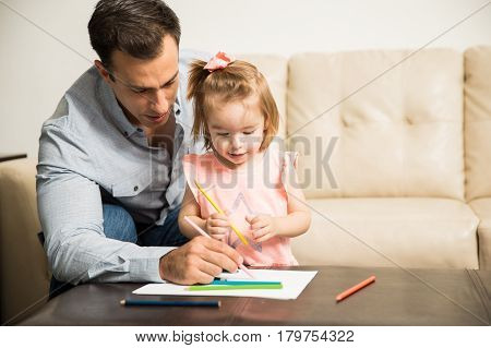 Happy Father And Daughter Coloring A Book