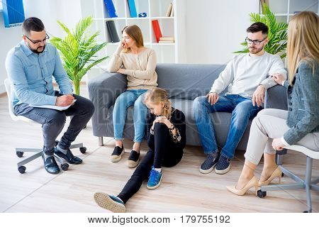 A rebellious teen daughter in family therapy