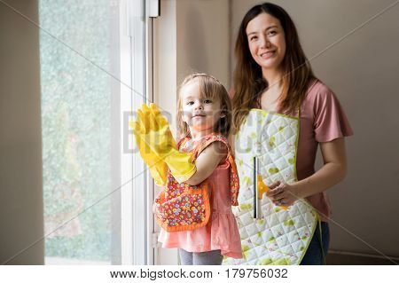 Mother And Daughter Finished Cleaning Up