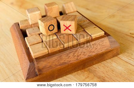 Right Or Wrong With Tic Tac Toe Game On The Wood Table