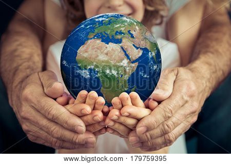 Family Holding Earth Planet In Hands