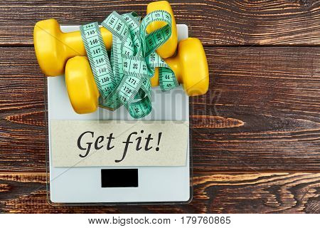 Scales, card and dumbbells. The greatest wealth is health.