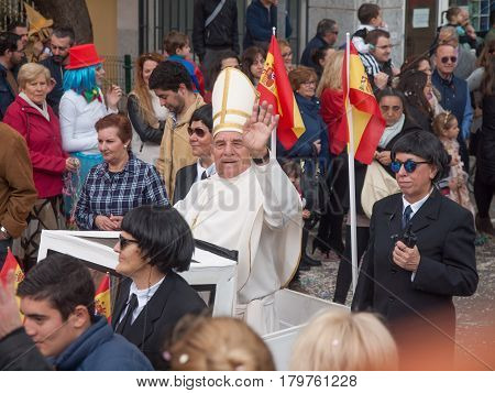 ALGECIRAS SPAIN - MARCH 05 2017: Participants dressed as pope and bodyguards during the parade of the carnival in the street in Algeciras Cadiz Andalusia