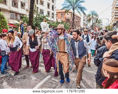 ALGECIRAS SPAIN - MARCH 05 2017: Carnival participants (Chirigota) celebrating during the parade of the carnival in the street in Algeciras Cadiz Andalusia