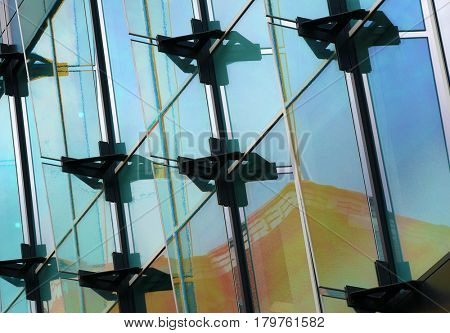 Closeup of window reflections on modern office building