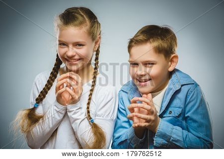 Cunning boy and girl conceived trick. Communication concept