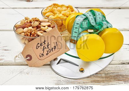 Kitchen scales and measuring tape. Make healthy normal.