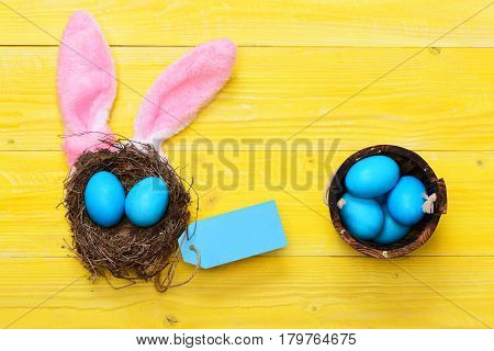 Traditional Eggs Painted In Blue Color With Nest And Busket