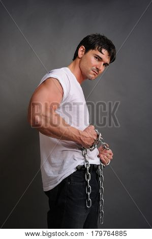 The hot guy is holding a chain.