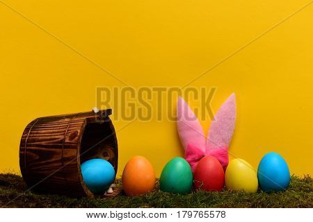 Colorful Happy Easter Handmade Eggs With Bucket And Rabbit Ears