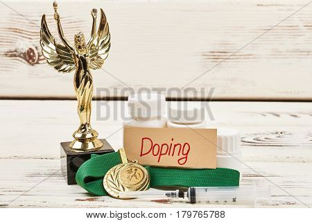 Awards and container with doping. Ways to be disqualified from sport.