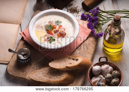 Vichyssoise soup on the white wooden table horizontal