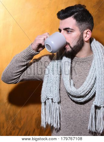 Bearded Man Drinking Tea, Coffee From Cup With Serious Face