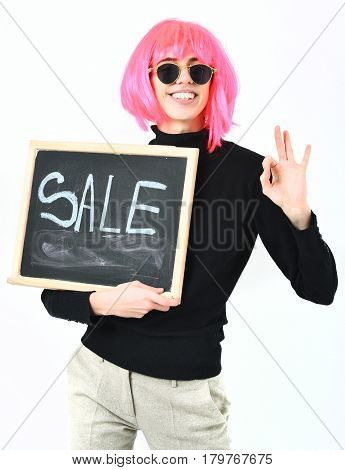 Fashionable Girl In Wig Holding Board With Sale Inscription