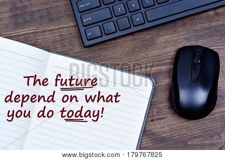 Text The future depend on what you do today on notepad page