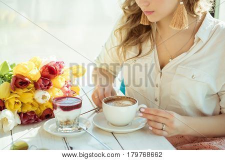 Morning. Girl with a Cup of coffee and yogurt